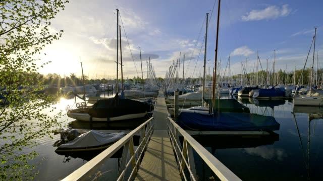 marina harbor langenargen at sunrise, bodensee, baden-württemberg, germany - segelschiff stock-videos und b-roll-filmmaterial