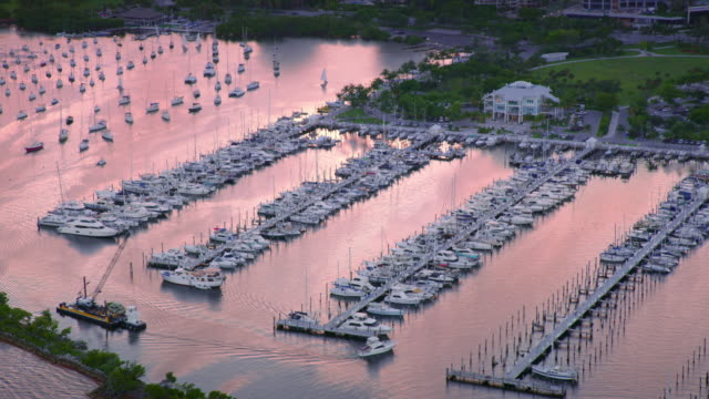 aerial marina in miami-dade county, fl at sunset - miami dade county stock videos & royalty-free footage