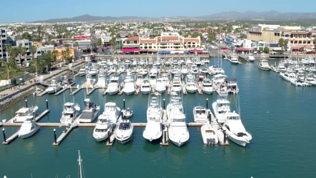 marina of luxury yachts in cabo san lucas baja california mexico - cabo san lucas stock videos and b-roll footage