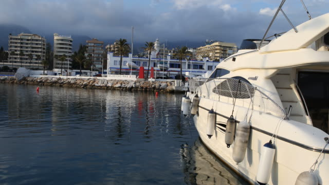 Marina of Marbella in Andalusia in Spain at sunset a lot of boats can be seen