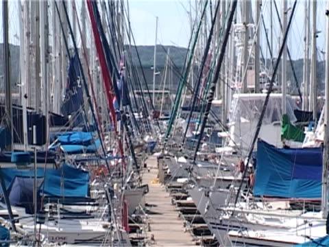 vídeos y material grabado en eventos de stock de marina showing commercial world overlapping with marine environment, ms - elmina
