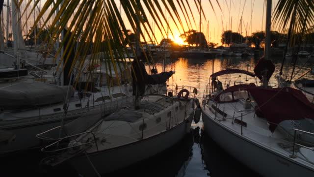 marina sunset sailboat boat in the vuda marina harbor. - slow motion - fiji stock videos & royalty-free footage
