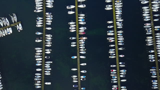 marina with boats and yachts seen from above - small boat stock videos & royalty-free footage