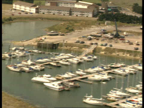 stockvideo's en b-roll-footage met business monopoly threatens yachting cr2746 england hampshire southampton marina boats seen on river yachts in marina - southampton engeland