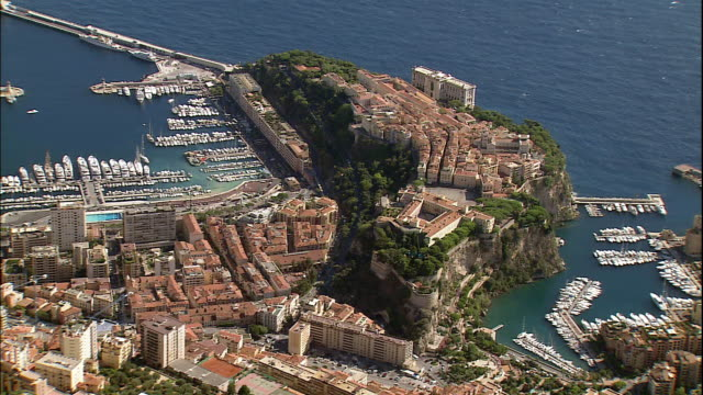 marinas surround the oceanographic museum on the french riviera. - monaco stock-videos und b-roll-filmmaterial