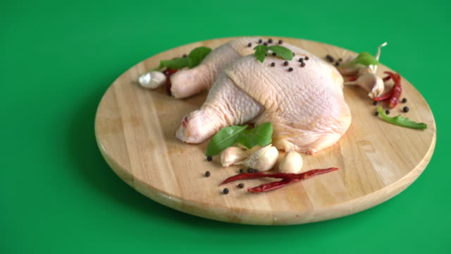 marinated chicken thigh with sauce on green screen
