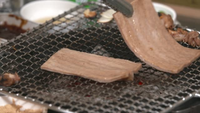 marinated pig skin on the grill - peel plant part stock videos and b-roll footage