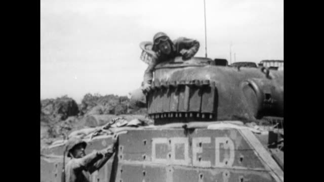 marine armor regiment on top of m4 sherman tank talking w / another / vs sherman flame tanks shooting fire across landscape burning pov from tank... - schlacht um iwojima stock-videos und b-roll-filmmaterial