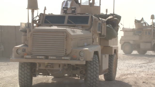 U.S. Marine armored trucks park at the front of a convoy.