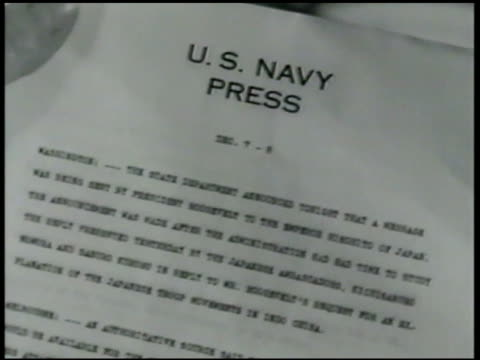 Marine at table reading paper CU 'Navy Press' VS Marines 'Japs are still in Washington Peace talks will be renewed think those guys are bluffing'...