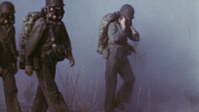 S Marine combat corpsman recruits undergoing field training wearing gas masks donning and stripping them off / Camp Lejeune North Carolina United...