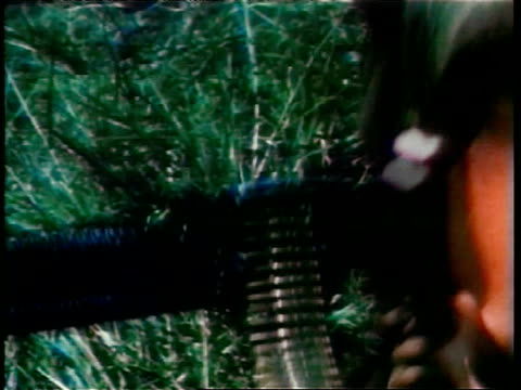 marine combat forces in vietnam war / cu soldiers' hands loading ammunition into m60 machine gun in grass / soldier shooting m60 machine gun in field... - m16 stock videos & royalty-free footage