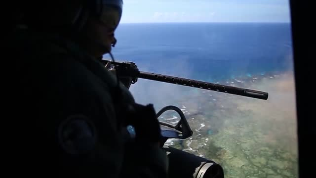 US Marine Corps AH1Z Viper and UH1Y Venom helicopters with Marine Light Attack Helicopter Squadron 469 fly over Okinawa Japan after conducting...
