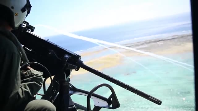 us marine corps ah1z viper and uh1y venom helicopters with marine light attack helicopter squadron 469 fly over okinawa japan after conducting... - attack helicopter stock videos and b-roll footage