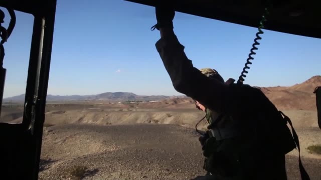 marine corps air station yuma arizona search and rescue helicopter and crew performing a 100 ft rappel and simulated shorthaul rescue their primary... - hospital corpsman点の映像素材/bロール