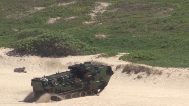 US Marine Corps and Japan Ground SelfDefense Force service members conduct amphibious training during Rim of the Pacific Exercise 2014