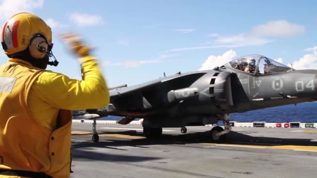 A US Marine Corps AV8B Harrier jet with Marine Medium Tiltrotor Squadron 263 22nd Marine Expeditionary Unit launches off the flight deck of the USS...