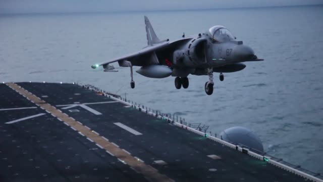 marine corps av-8b harrier jets with marine medium tiltrotor squadron 263 , 22nd marine expeditionary unit , take off from the flight deck of the uss... - aircraft carrier stock videos & royalty-free footage