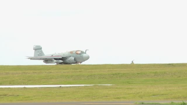 marine corps brig. gen. steven r. rudder, 1st marine aircraft wing commanding general, takes off from andersen afb, guam, in an ea-6b prowler,... - guam video stock e b–roll
