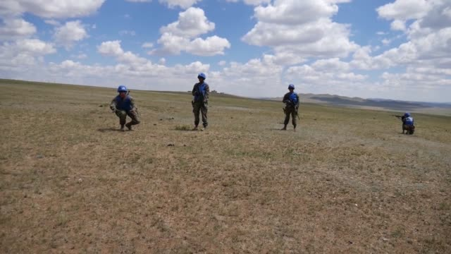 us marine corps pacific peacekeepers observe and engage with simulated rebel forces june 18 at five hills training area mongolia during a khaan quest... - military exercise stock videos and b-roll footage