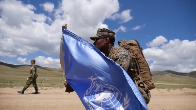 us marine corps pacific peacekeepers observe and engage with simulated rebel forces june 18 at five hills training area mongolia during a khaan quest... - 平和維持点の映像素材/bロール