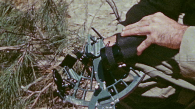 marine examining a box containing binoculars with a sextant for directing artillery fire / okinawa japan - sextant stock videos & royalty-free footage