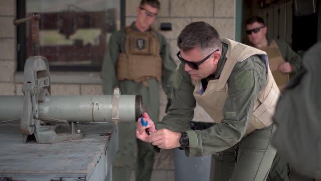 vídeos y material grabado en eventos de stock de us marine explosive ordnance disposal technicians carry out disposal procedures on a mk22 mod 4 rocket motor at marines corps base camp pendleton... - vegetal con hoja