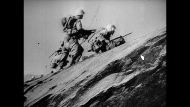 marine firing on dead body of japanese soldier lying on iwo jima beach us soldiers using flamethrowers dead burning body various us soldiers moving... - battle of iwo jima stock videos & royalty-free footage