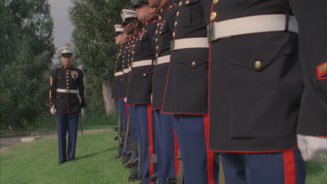 a marine honor guard prepares for a 21 gun salute. - saluting stock videos & royalty-free footage