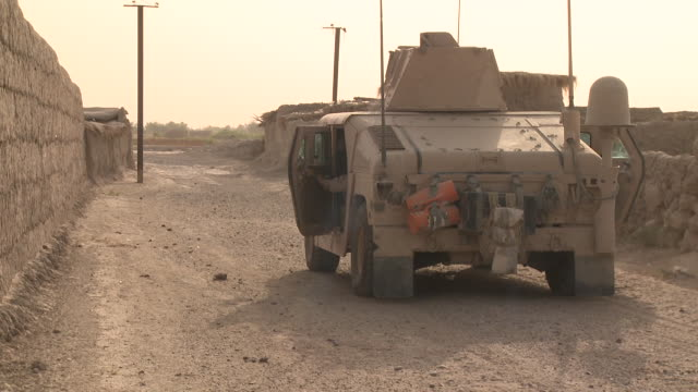 a u.s. marine humvee convoy stops in an afghan village. - convoy stock videos and b-roll footage