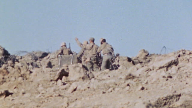 marine infantry crossing rocky ridge at a run / iwo jima japan - battle of iwo jima stock videos and b-roll footage