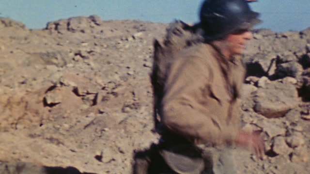 marine infantry descending slope with casualty on stretcher and loading casualty into waiting jeep ambulance / iwo jima japan - schlacht um iwojima stock-videos und b-roll-filmmaterial