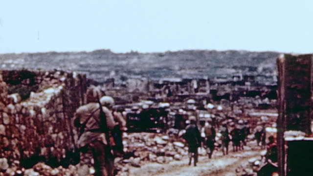marine infantry entering the city crossing a pontoon bridge over mud flats and crouching behind building rubble and fences / naha okinawa japan - pontoon bridge stock videos and b-roll footage