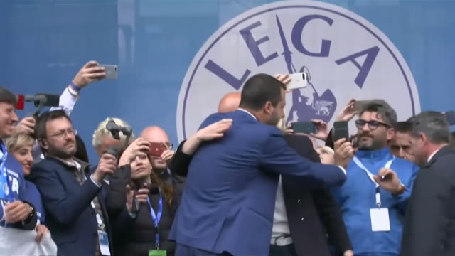 """marine le pen france and matteo salvini italy hugging on stage at joint rally in milan ahead of the european elections - """"bbc news"""" video stock e b–roll"""