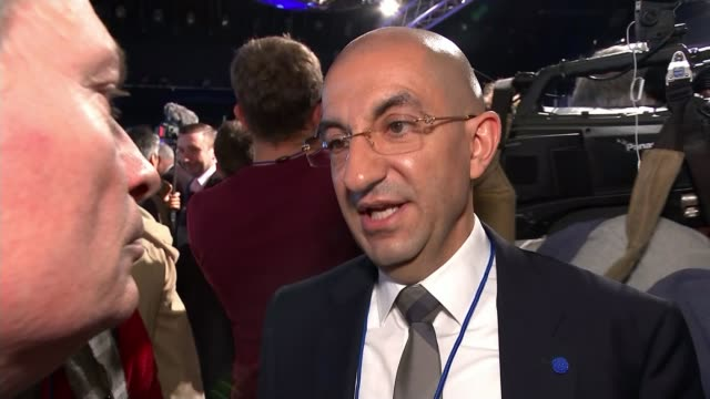 Marine Le Pen vows to rename and rebrand Front National Reporter talking to man wearing beret Woman with French flags standing by wine and glasses on...