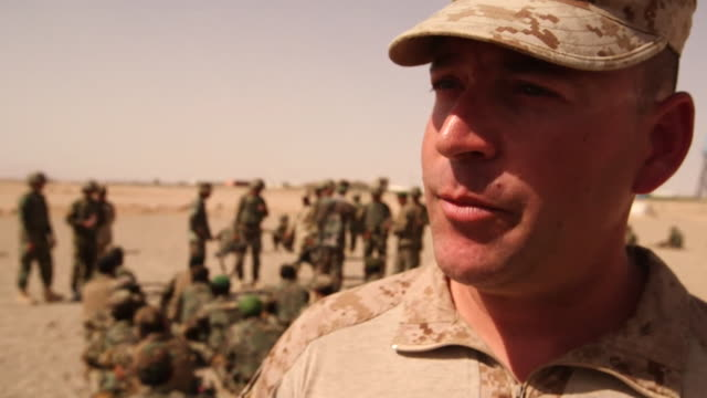 us marine lt col jon connelly saying despite depletion in afghan army troops in helmand province time and recruiting will improve the situation - military recruit stock videos & royalty-free footage