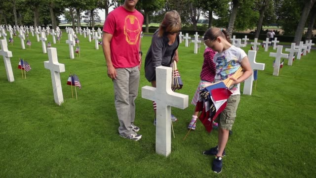 us marine mark weinrich his wife kathryn and their daughters charlie and emily help plant us and french flags at the graves of us soldiers most of... - 100th anniversary stock videos & royalty-free footage