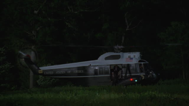 ms, marine one helicopter on clearing, two men exiting, usa - western script stock videos & royalty-free footage