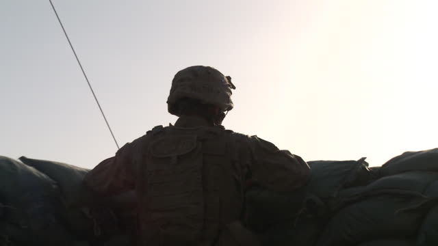 a u.s. marine peers over sandbags in an emplacement. - sandbag stock videos and b-roll footage