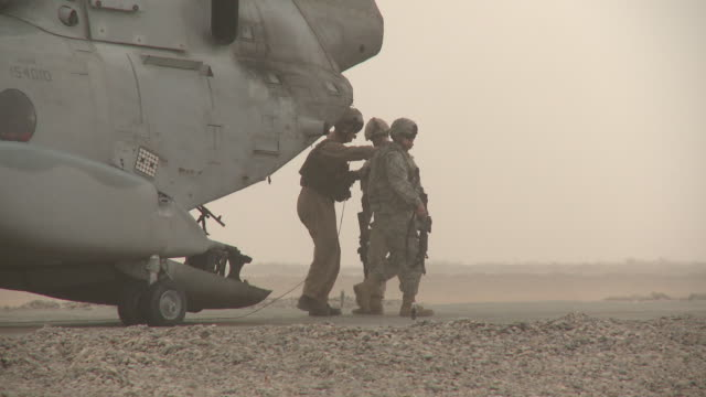 u.s. marine riflemen disembark from a ch-46 transport helicopter. - us marine corps stock videos & royalty-free footage