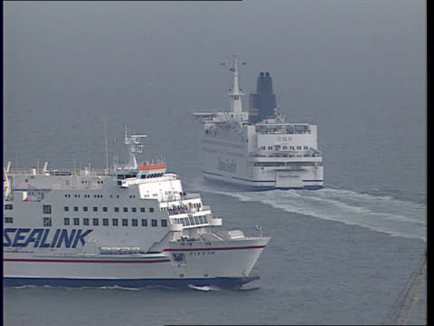 stockvideo's en b-roll-footage met marine safety agency orders ferry checks after sinking of estonia england dover tlbv one ferry away on water as side sealink ferry past lr in... - ferry