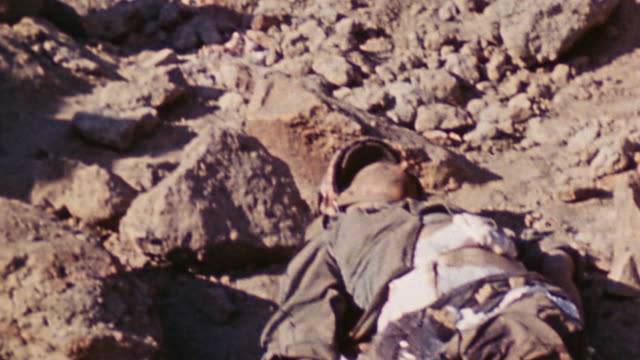 tu marine sharing natural ravine with japanese casualty lying where he fell / iwo jima japan - battle of iwo jima stock videos and b-roll footage