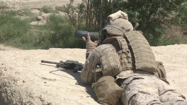 A U.S. Marine sniper team spotter looks for targets of opportunity.