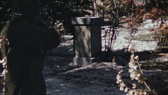 marine taking aim and firing m1 rifle at japanese shrine during wwii - rifle stock videos & royalty-free footage