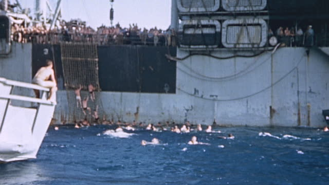 marine underwater demolition team climbing down the side of uss hansford and swimming in the ocean as training maneuver during world war ii pacific... - pacific war stock videos and b-roll footage