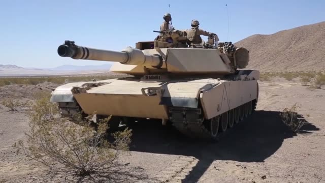 marine with alpha company 1st tank battalion conduct attacks on mock enemy position during exercise desert scimitar 2014 the training gave the marine... - armoured vehicle stock videos & royalty-free footage