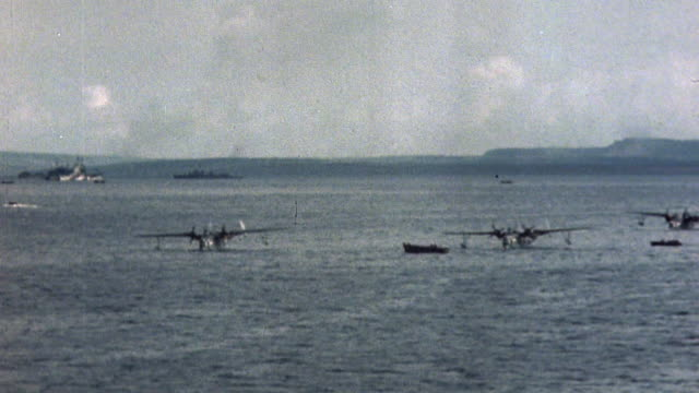 mariner seaplanes and auxiliary ships at anchor off saipan coast during wwii - saipan stock videos and b-roll footage