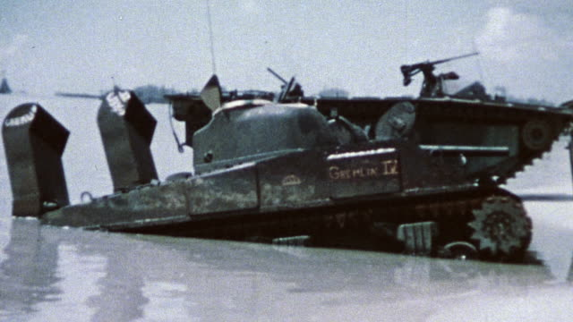 stockvideo's en b-roll-footage met marines aboard dukw amphibious vehicles patrolling beach front during wwii - slagfront