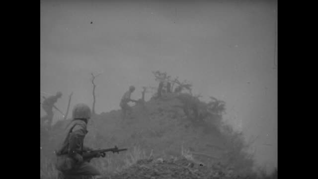 vidéos et rushes de marines advance in battle of okinawa explosions / young marine solo on hill / marines help wounded comrade walk / marines hurry to carry stretcher up... - artillerie lourde