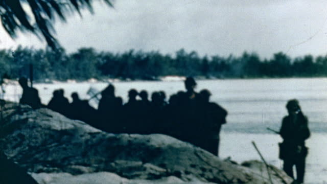 us marines advancing inland from the beach during wwii pacific campaign / saipan mariana islands - mariana islands stock videos and b-roll footage